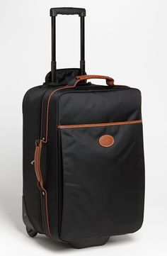 Longchamp Wheeled Carry-On. I am in need of some chic luggage.