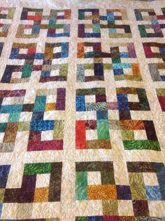 Waste Knot quilt in rainbow batiks