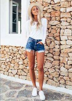 white sneakers with cut off shorts and white top