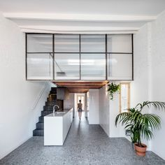 The Barcelona-based studio peeled back the existing ceiling slabs, revealing the attic area and enabling the architects to expand the single-level apartment – named La Dominique – into a two-storey loft with a bedroom on the second floor. Small Attic Room, Attic Rooms, Attic Spaces, Attic Renovation, Attic Remodel, Mezzanine Floor, Attic Floor, Journal Du Design, Slanted Walls