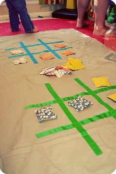 bean bag tic-tac-toe. This would be fun for parties. Could be done with bean bags and just tape on the floor.
