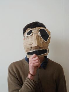 Cardboard Head Sculpture by David Whelan Cardboard Mask, Cardboard Sculpture, Photo Repair, Paper Mask, Art Textile, Diy Mask, Headgear, Mask Design, Masquerade