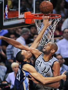 BLOCKED Memphis Grizzlies Tayshaun Prince, left, is fouled by San Antonio Spurs Tim Duncan during the second half of Game 1 of the Western Conference final NBA basketball playoff series, Sunday, May 19, 2013, in San Antonio. (Darren Abate/AP)