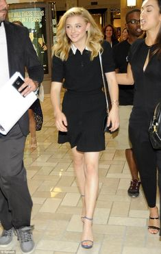 Places to be: The Carrie star was lead through the shopping centre where she greeted fans...