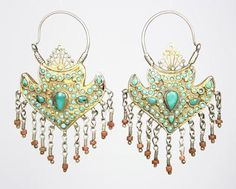 Uzbekistan | Dating from about 1880 these fine antique gilt silver earrings are probably Jewish work from Bukhara. | They are set with Persian turquoise and have coral colored glass bead dangles.