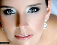 Green eyes highlighted with those face framing earings and shimmery eyes! | PerfectWeddingGuide.com #PWGSHOW