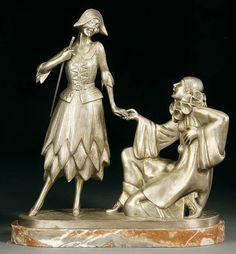 A French Art Deco Woman and Harlequin Bronze Sculpture by Grainger.