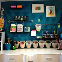 Craft room home office. Combine pegboard with Ikea kitchen organization and framed art for a cool industrial look and a lot fewer holes in the wall.
