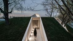 In the city of Tangshan, in China's Hebei province, Han Wen-Qiang's Archstudio has created a Buddhist shrine in the forest by the area's river. In 169 square meters, the celebrated architect's design sets out to provide as little disruption possible, instead focusing on advancing a sense of unity and flow.