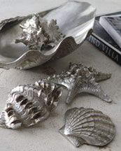 Coastal decor spray painted silver for a classy look! I kinda like this.