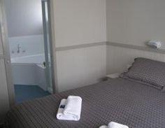 Master bedroom with ensuite - Condo Spa - Narooma accommodation Bedroom With Ensuite, Master Bedroom, Holiday Park, Condo, Spa, Cabinet, Storage, Furniture, Ideas