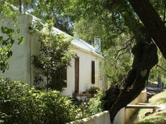 Beaumont Wines Cottages, two lovely 1 bedroom self-catering farm cottages on working wine farm in Bot River. Pepper Tree, Farm Cottage, Open Fireplace, Cold Night, Kitchen Wood, Cotton Bedding, Stoves, Water Bottles, Wood Burning