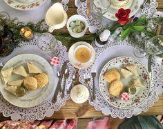 Cream tea with tea sandwiches, scones, clotted cream, custom floral sugar cubes, abd strawberry jam
