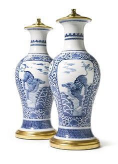 A pair of Chinese porcelain blue and white vases, mounted as lamps 19th century, height of vases 16 3/4 in. Estimate 2,500 — 3,500 USD LOT SOLD. 3,438 USD