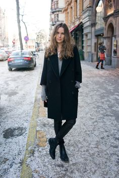 Wearing a coat from Miu Miu, boots from Balenciaga, leather leggings from Helmut Lang and a cashmere sweater from H&M (the mens section).