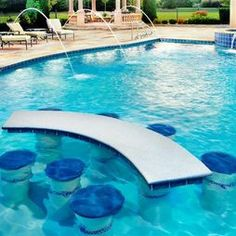 I always wanted a pool with a table in it!