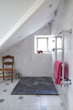 [1st floor bathroom] mandarin stone honed calacatta and [blue/black?] shower tray? They do have honed calacatta shower trays too.