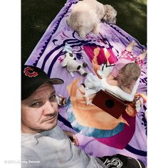 """Jeremy Renner's image - """"Press pause. Play picnic. Life is good! #blessed #daddytime #sunshine"""" on WhoSay"""