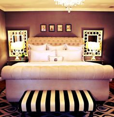 Mirrors behind the bedside lamps. Doubles the light in the room (love the bench too)