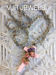 Treasurehunting I bumped into a vintage pink cross which I pimped with flowers , resored the antique cristal necklace and gave them a second life , For sale do mail for prices