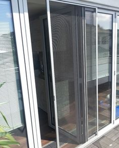 The Picture Shows A Sliding Door Whose Screen Is Pushed To Be Partially  Open Tou2026
