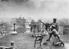 Rooftop Defenders in Tokyo - HU036739 - Rights Managed - Stock Photo - Corbis. Two gunners man an anti-aircraft gun on the roof of a Tokyo department store in the last days of World War II. American planes bombed Japanese cities heavily from early in 1945 up until the bombings at Hiroshima and Nagasaki, and succeeded in crippling most of Japan's urban areas.