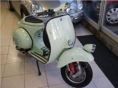 """1961 Vespa VBB L152 with 10"""" wheel conversion, Malossi 210cc PX engine and SIP racing seat."""