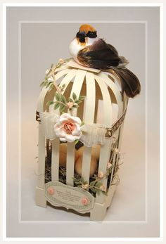 """paper birdcage template-Yes, quill all of the flowers and stems, and glue them onto 1"""" wide cardstock quilling strips to make a pretty birdhouse like this one - and you could even quill the bird!. Aren't they beautiful?"""