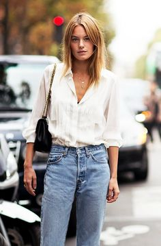 A white shirt or blouse on a jeans, classy but fabulous if you wear it a little baggy in your pants.