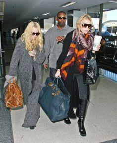 Mary-Kate rocking a Balenciaga motorcycle bag, and Ashley with an oversize Hermès Birkin and crocodile Fendi Twin bag
