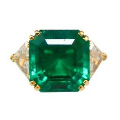 Cartier 18 ct emerald, diamond ring, offered on 1stdibs.