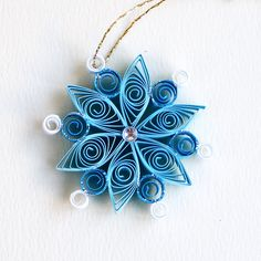 https://flic.kr/p/AzXSb4 | 6 point small turquoise and white quilled snowflake with silver glitter