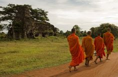 Buddhist Monks at Banteay Top Buddhist Monks passing by Banteay Chhmar Temple, Cambodia. Location: Banteay Chhmar, Cambodia.
