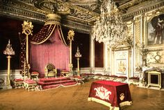 Vintage photograph with photochrome coloring, showing the throne with curtains swept aside in the throne room of Fontainebleau Palace, a cry...