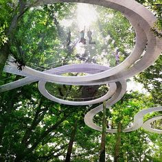 Elevated Forest Park Includes a Trampoline to Bounce Among the Treetops Outdoor Trampoline, Trampoline Park, Glass Cabin, Pavillion, Plakat Design, Parking Design, Sustainable Energy, Forest Park, Tree Tops