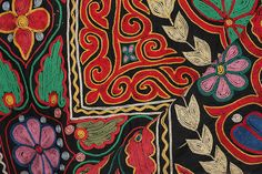 Kazakh embroidery on a traditional Kazakh rug. Rug purchased and photographed by by Mark Heard, via Flickr