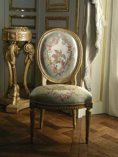 Rococo chair. This fits the Rococo style because it began with interior design. The style was influenced by French aristocrats wanting to bring the Baroque style from the Palace of Versailles into their new homes and it evolved into the new Rococo style. They loved the elaborate floral patterns. A lot of Rococo pieces were textile and wood, like this chair, because they were furniture pieces.
