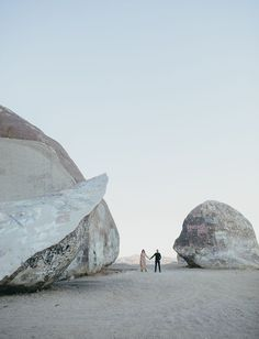 The giant rocks add such beautiful drama to this engagement shoot! Photo Credit: http://www.tangerinetreephotography.com/. From http://greenweddingshoes.com/palm-springs-giant-rock-engagement-session-molly-evan/.