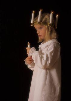Christmas in Scandinavia. Little girl dressed for Santa Lucia.