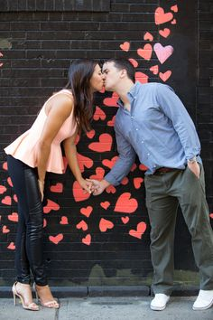 Cute Heart Backdrop for Engagement Pics - See more on #smp here:  http://www.StyleMePretty.com/tri-state-weddings/2014/04/17/new-york-city-engagement-session-4/ Photography: TheoMiloPhotography.com