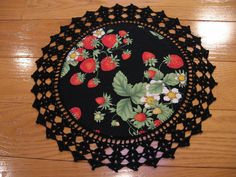 Aunt Roo's Strawberry Timeless Treasures fabric doily (reverse HALLOWEEN Bell Knobs and Broomsticks) w/ crocheted edging...