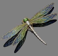 An enamel and diamond dragonfly brooch The old brilliant-cut diamond body with green enamel eyes, between delicate green and blue plique-á-jour enamel wings highlighted with rose-cut diamonds, diamonds approx. 0.80ct total, detachable brooch fitting, French assay mark, maker's mark, width 12.0cm