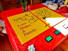 Love Makes A Family - thumbprint canvas for adoption party. Started this and messed it up, got help from a real artist who primed the canvas, spray painted base color and used acrylic for the tree.  Scrapbook paper cut letters using a Cricut, archival Color Box ink pads in 3 shades of green - varnish when complete