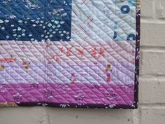TAKE A BIG STEP BABY QUILT-ALONG: PART II--Giuseppe Ribaudo- Part II...First thing's first. Baste your quilt. I laid my backing down, then my batting, then my top. I like for the batting and backing to be about three inches wider than my quilt top....