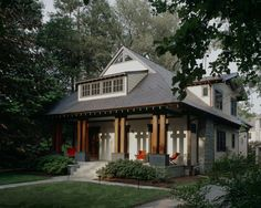 """This renovation and addition to a 1920's era bungalow is the story of the stewardship of an existing resource from a state of aging into a """"second life,"""" blending tradition and modernity in form and detail. A garden addition and new second floor were configured under a new form-hugging roof that kept the bungalow character, yet blended with the asian-modern sensibility that guided the design. The front of the house preserves the bungalow character while hinting at the modern transformation."""