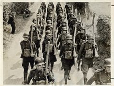 "Irish Troops marching in formation during the ""Emergency"", when neutral Ireland prepared for possible invasion by Nazi Germany. Lee Enfield, Irish Free State, German Helmet, Mario, Army Uniform, Military Uniforms, Defence Force, Army Soldier, Military History"
