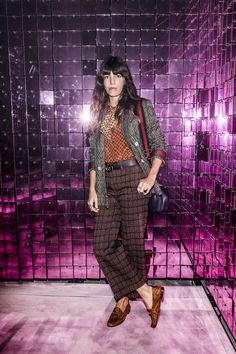Lou Doillon in a Gucci Fall Winter 2016 wool double-breasted jacket with Web detail, an orange paisley silk shirt, silk jacquard plaid trousers, loafers and Dionysus bamboo top handle bag.