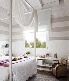 I love the tall ceilings and vertical stripes starting at about eye level.  I always liked the draped material over the bed.  I'd spend hours in here!