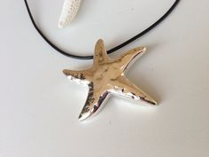 Silver plated starfish pendant on leather cord by Carolinelenox, $25.00