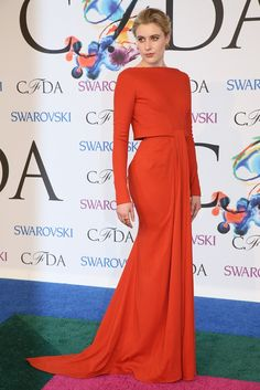 Zac Posen long sleeve red gown with knot at the waist